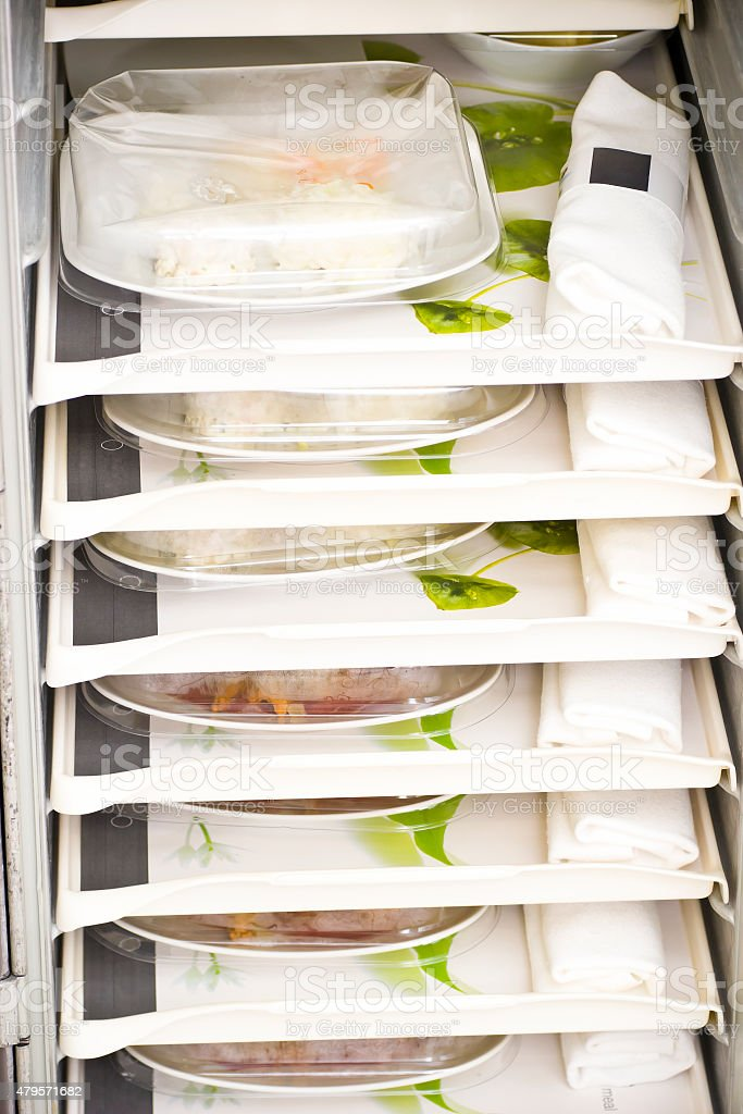 Airline service trolleys with meals for first class passengers stock photo