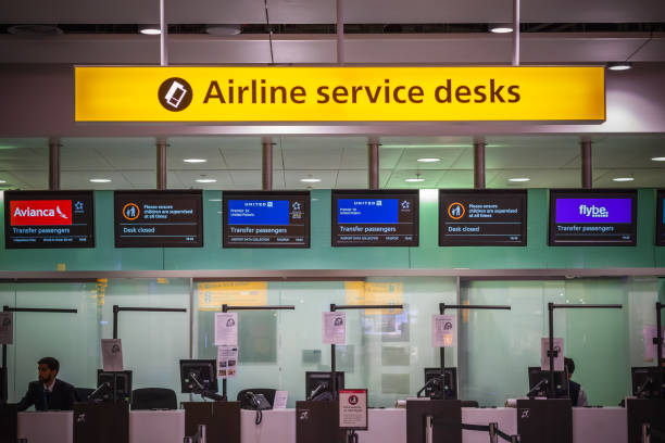 Airline services desks for transfer passengers at departure hall of London Heathrow Airport stock photo