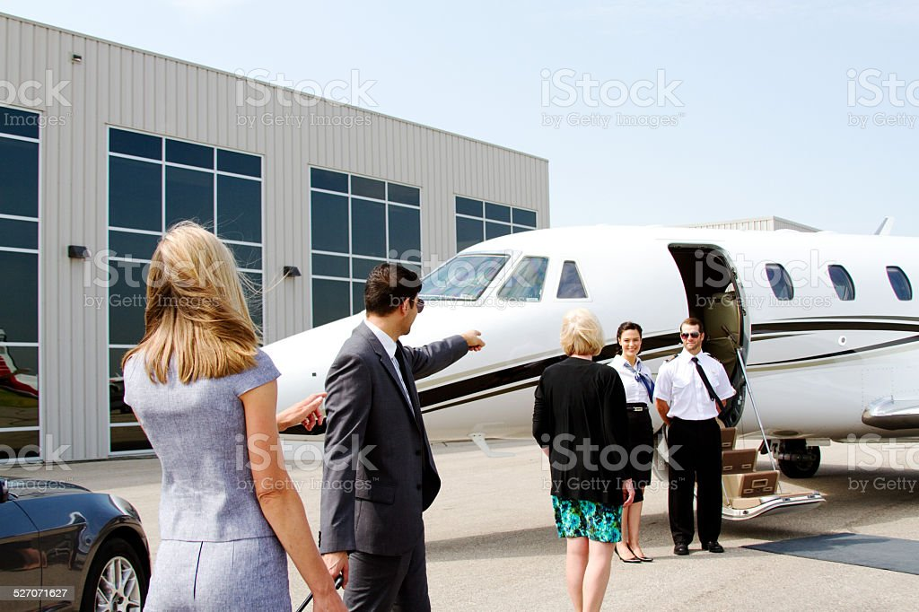 Airline staff waiting for passengers stock photo