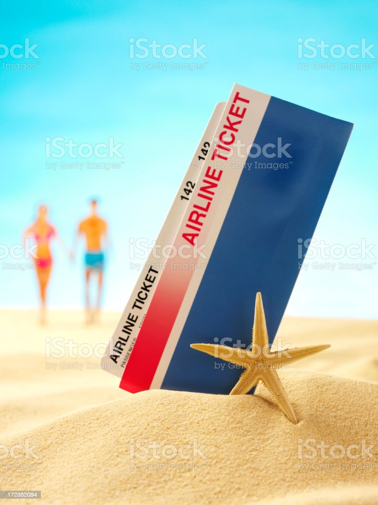 Airline Ticket and Boarding Pass in the Sand royalty-free stock photo