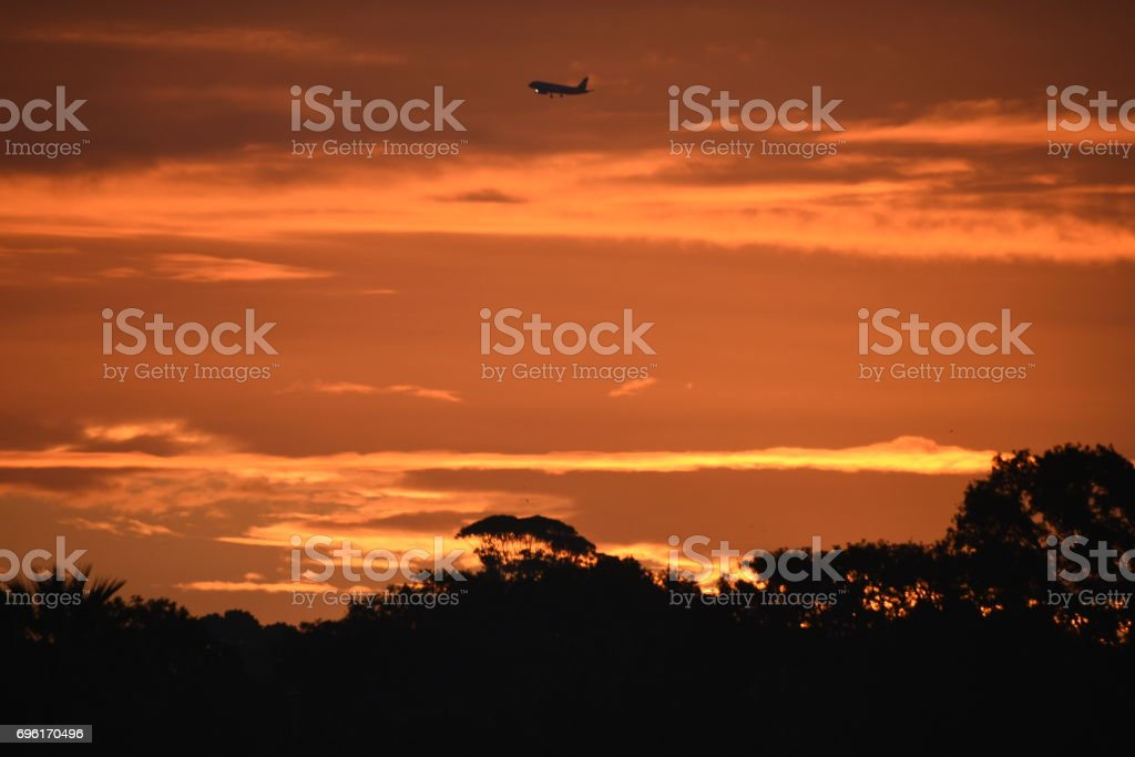 Airliner at sunset stock photo