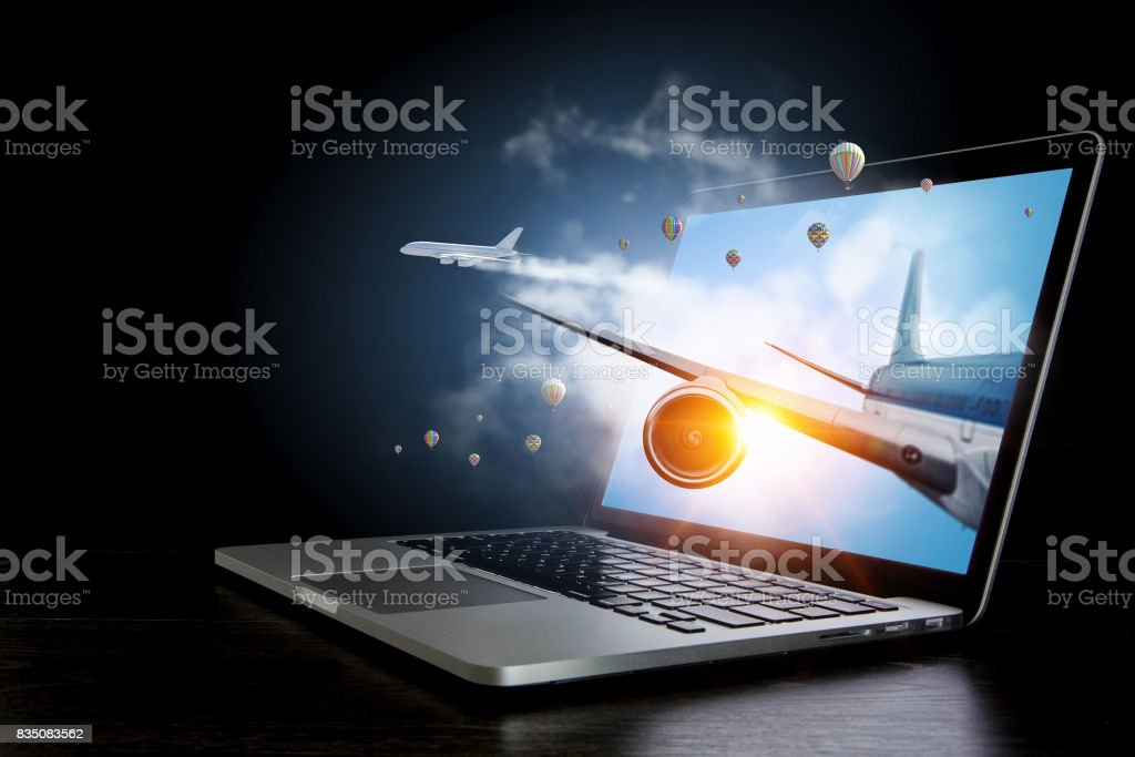 Airliner coming from laptop. Mixed media . Mixed media stock photo