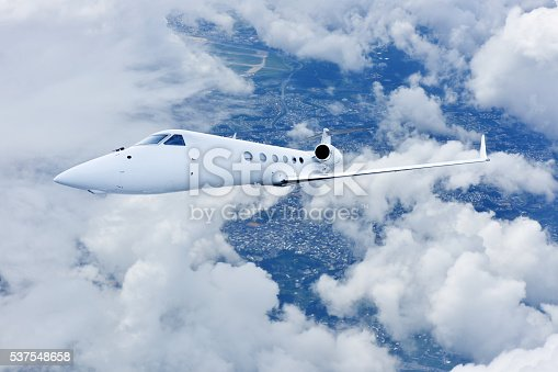 943681768 istock photo Airliner Flight in Blue Sky 537548658