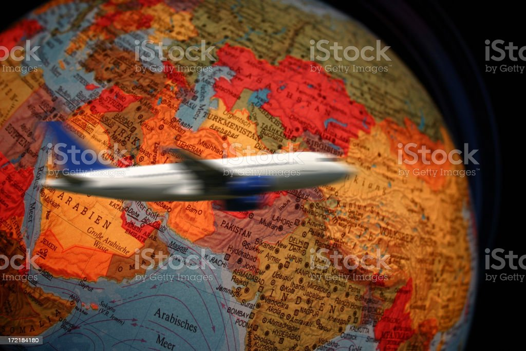 Airliner flying around globe royalty-free stock photo