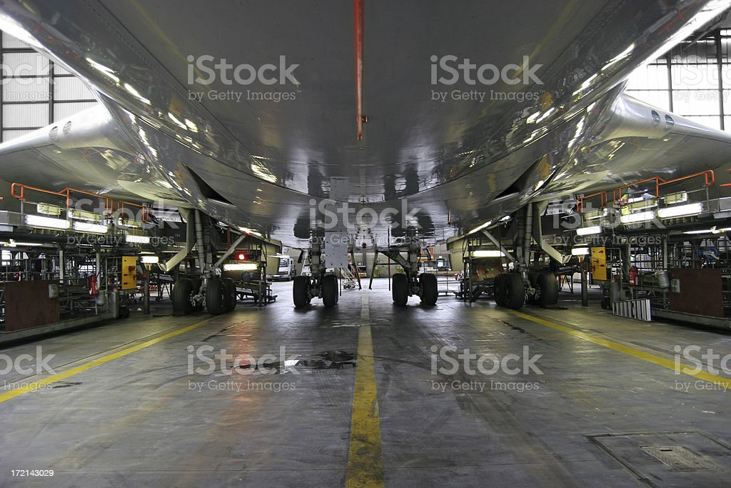 Airliner from below - maintenance stock photo