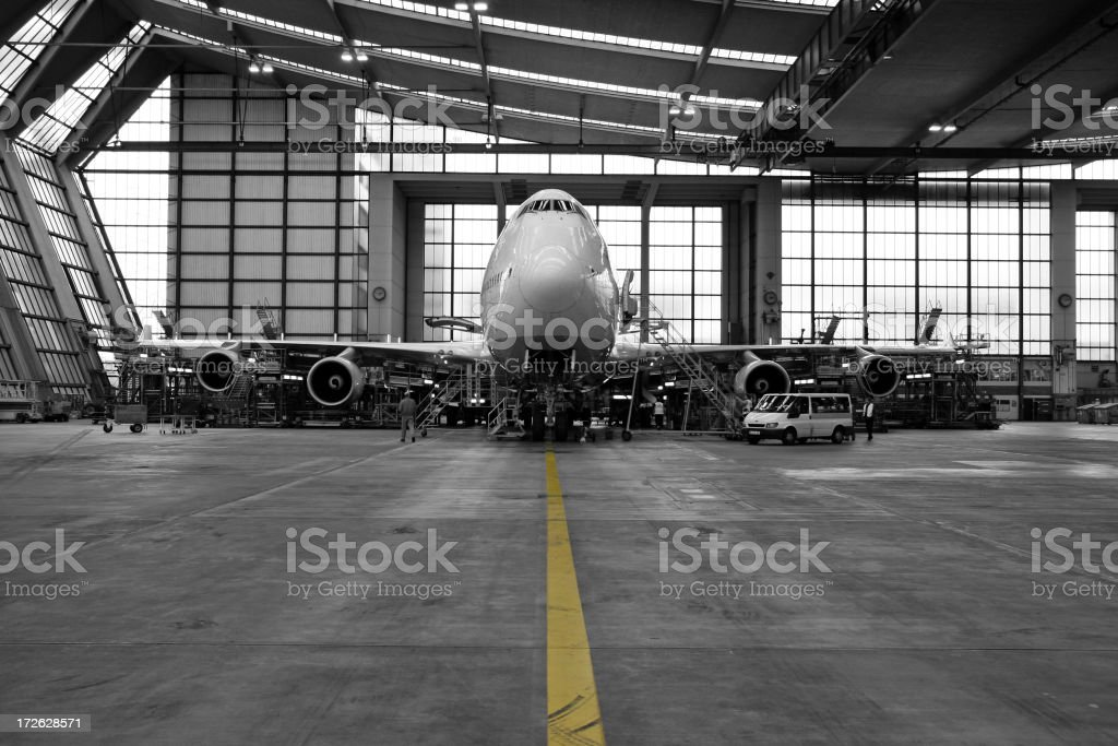Airliner in hangar - black and white stock photo