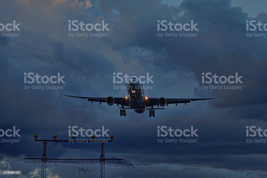 Airliner Landing in Storm stock photo