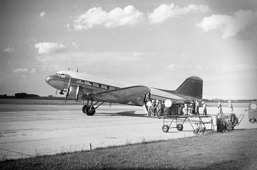 Commercial passenger airplane in 1951. DC-3. Scanned film with significant grain.