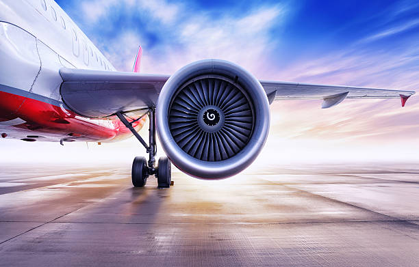 airliner on a airfield turbine of an airplane against the sun turbine stock pictures, royalty-free photos & images
