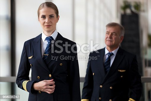 Airliner pilots waiting for flight at airport lobby