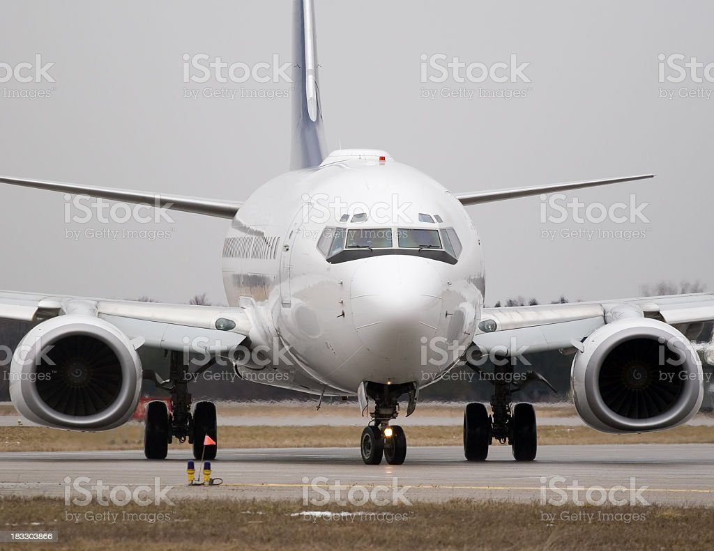 Airliner sitting on the runway royalty-free stock photo