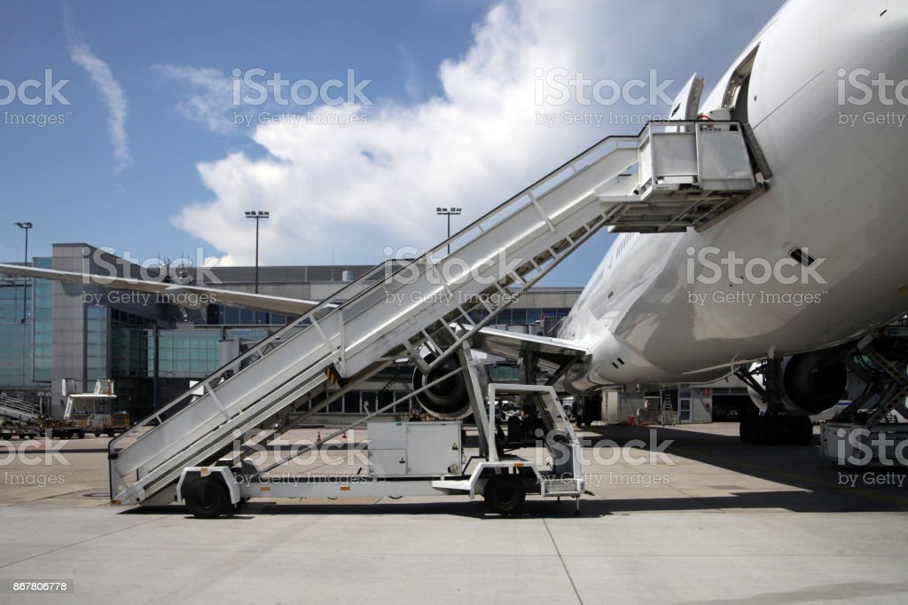 Airliner with boarding stairs stock photo