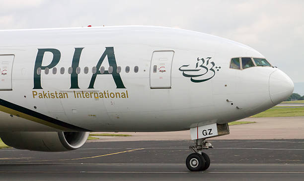 PIA Airlines Boeing 777 Manchester, United Kingdom - June 14, 2014: PIA Airlines Boeing 777 taxiing, Manchester International Airport. Prime Minister of Pakistan, Mr. Muhammad Nawaz Sharif, has expressed resolve to make PIA World's leading airline.  lahore pakistan stock pictures, royalty-free photos & images