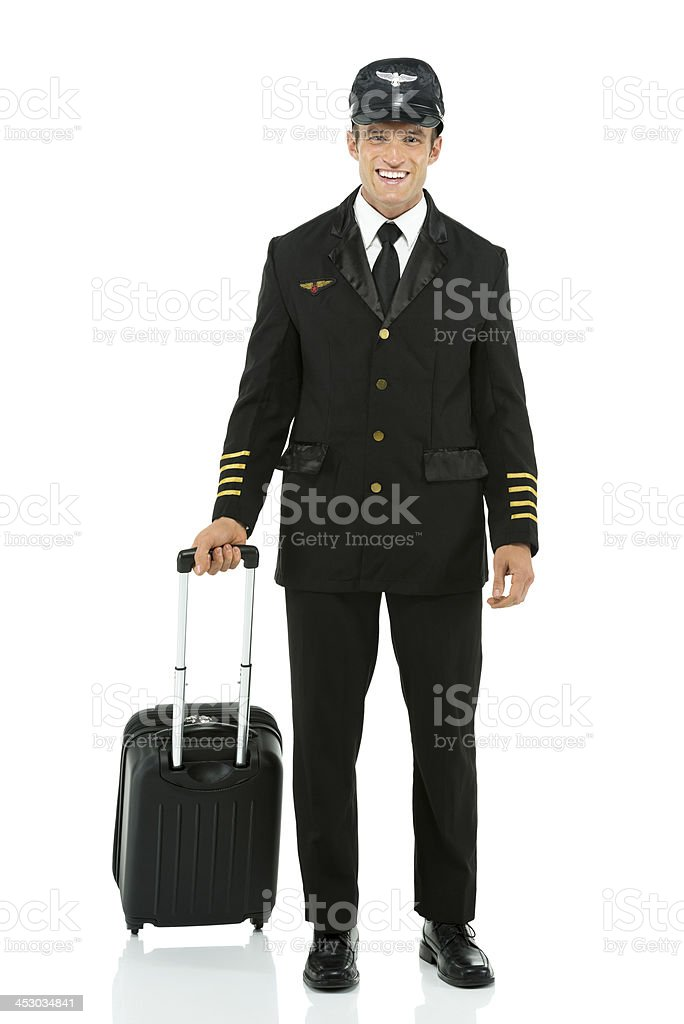 Airlines pilot standing with travel bag royalty-free stock photo