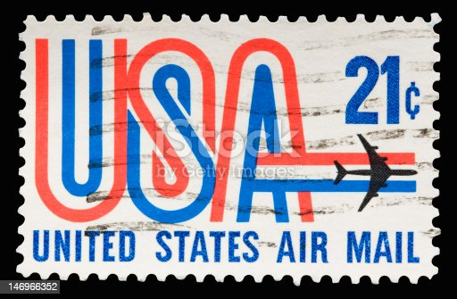 A 1968 issued 21 cent United States Airmail postage stamp showing USA with a plane.