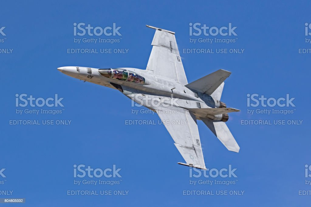Airpalne F-18 Hornet jet fighter flying at the air show stock photo