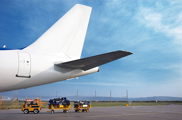 airplain tale and luggage cart stock photo