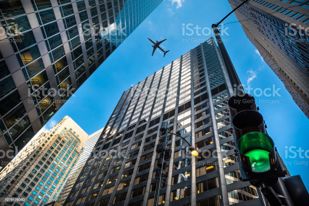Airplane above City Financial District in Chicago stock photo