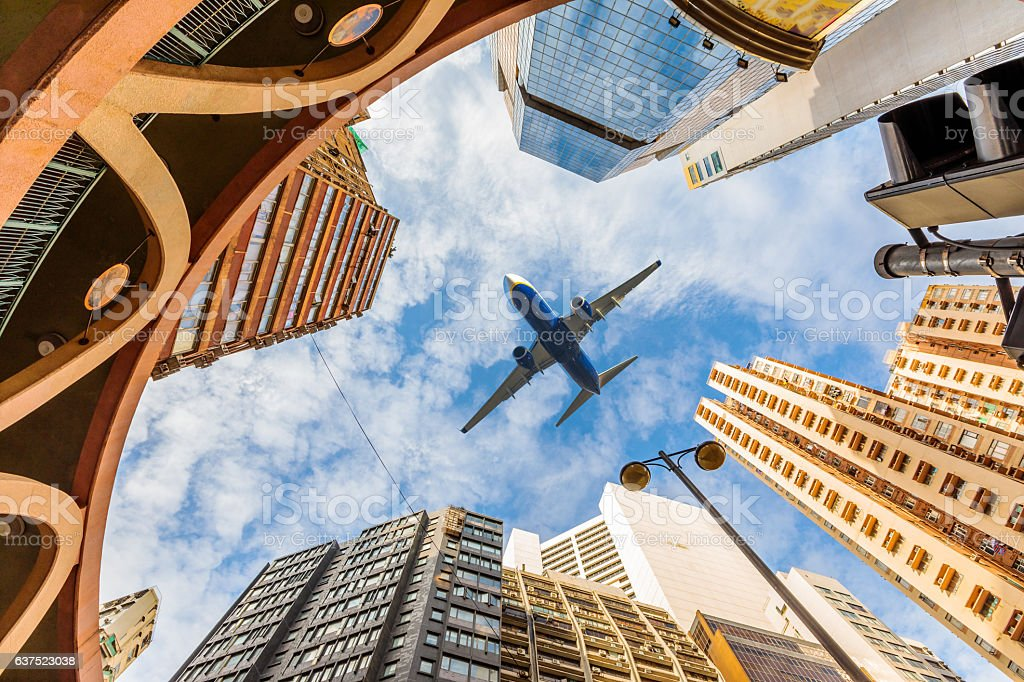 Airplane above city stock photo