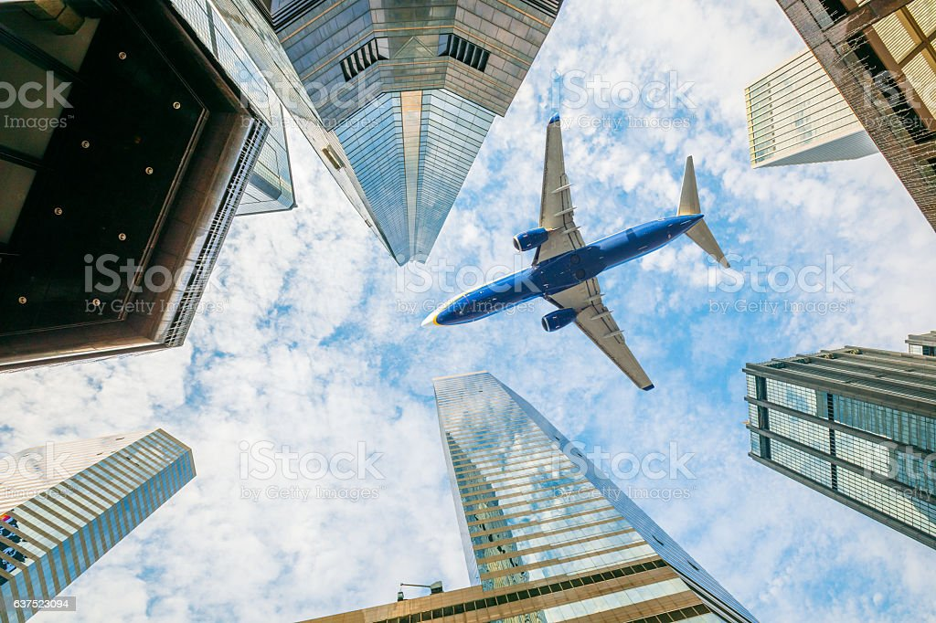 Airplane above city stock photo