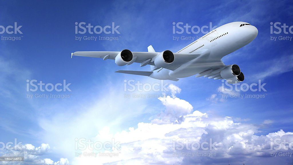 Airplane above the clouds stock photo