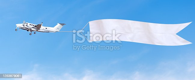 istock Airplane advertising banner 1253879061