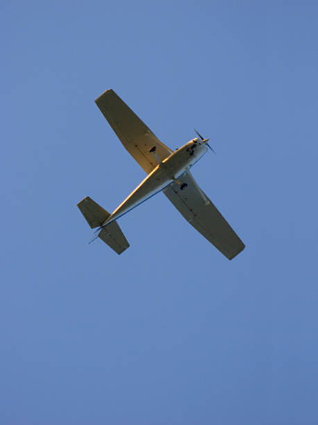 Airplane against a blue sky. stock photo