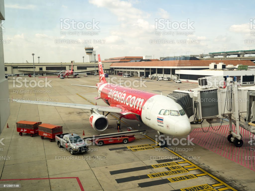 Airplane Air Asia Airways parking on Bangkok International Airport (Don Muang) Bangkok. Engineers are maintain the engine of the aircraft,Thailand. Oct 21 2016. stock photo