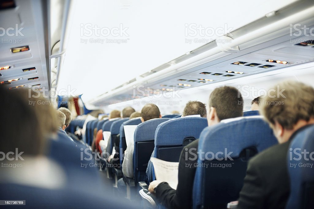 Airplane aisle with group of passengers stock photo