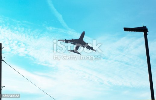 155380716istockphoto Airplane and blue sky 486239383