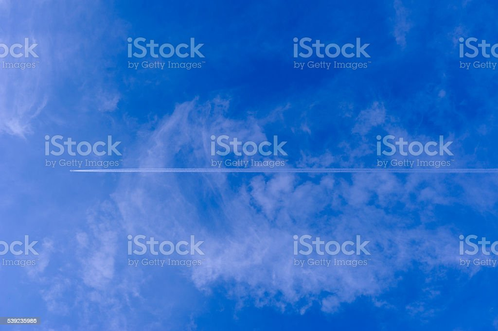 Airplane and blue sky royalty-free stock photo
