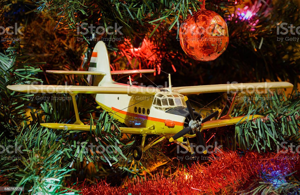 Airplane And Christmas Decorations With Pine Trees Stock