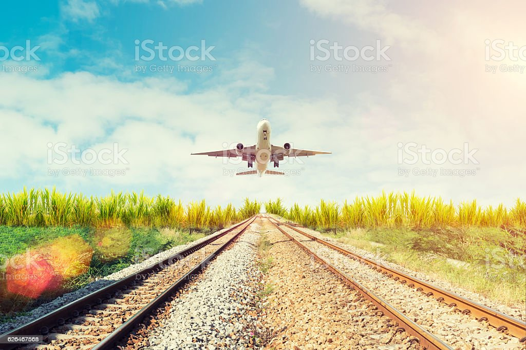 Airplane and railway at sunset. Travel or Transporttation backgr Airplane and railway at sunset. Travel or Transporttation background concept. Airplane Stock Photo