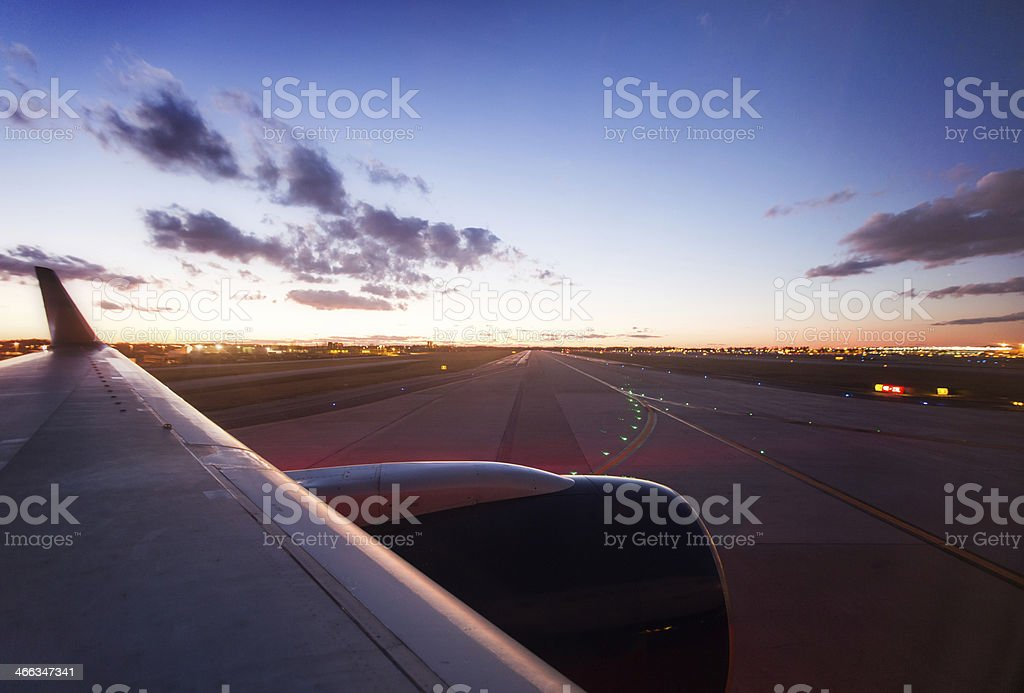 Airplane and Runway with Night Sky stock photo