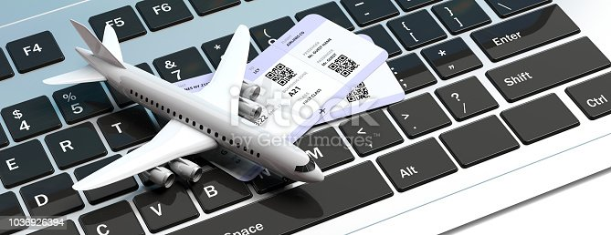 istock Airplane and two boarding passes, on computer keyboard. 3d illustration 1036926394