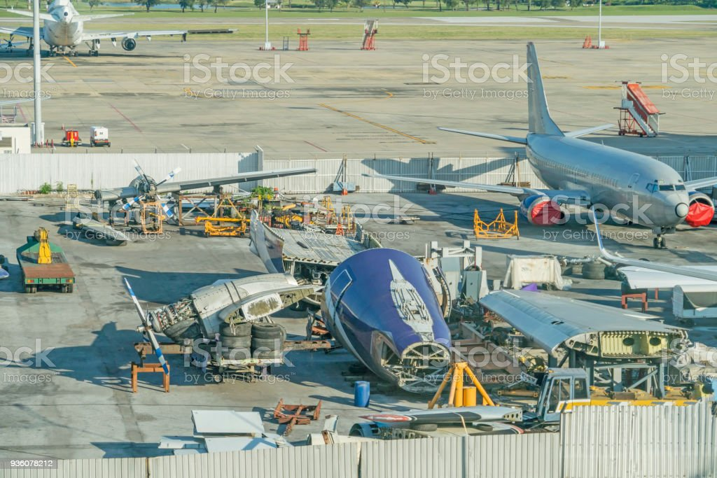 Airplane are disassembled to parts and old stock photo