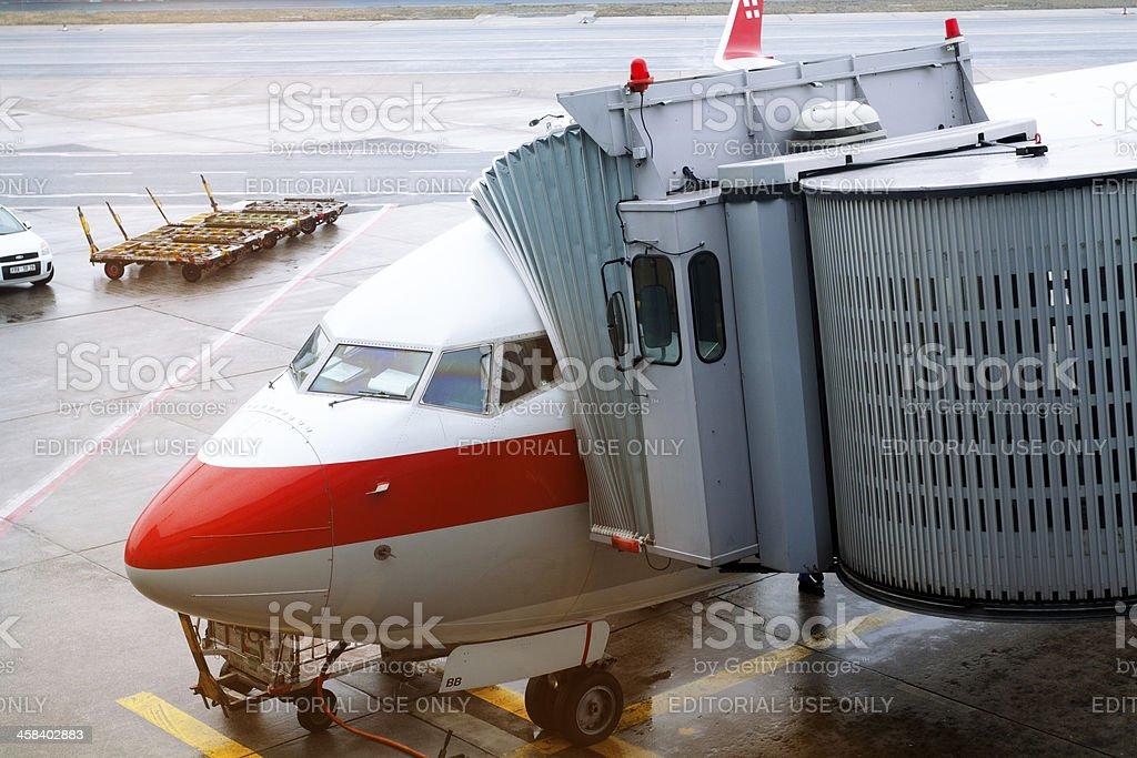 Airplane at airbridge royalty-free stock photo