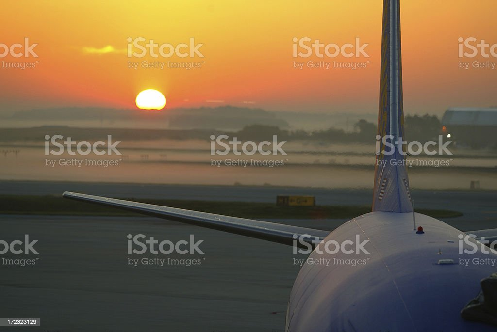 airplane at sunrise ready for business travel royalty-free stock photo