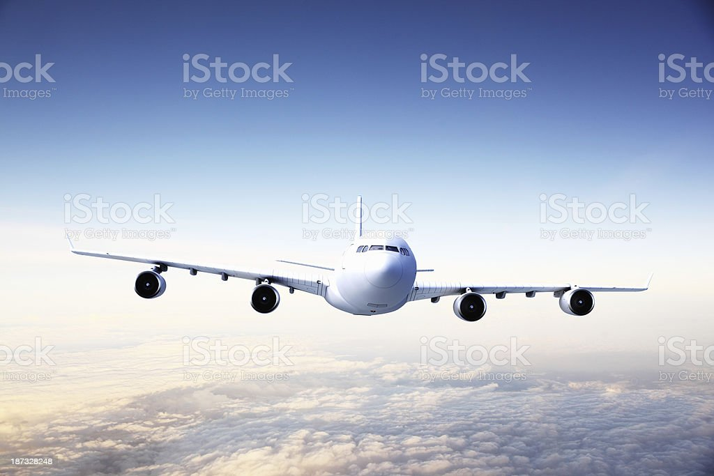 Airplane at sunset royalty-free stock photo
