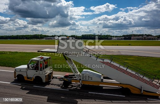 July 2, 2019, Moscow, Russia. Peron transporter tows the ladder to the plane at Vnukovo International Airport.