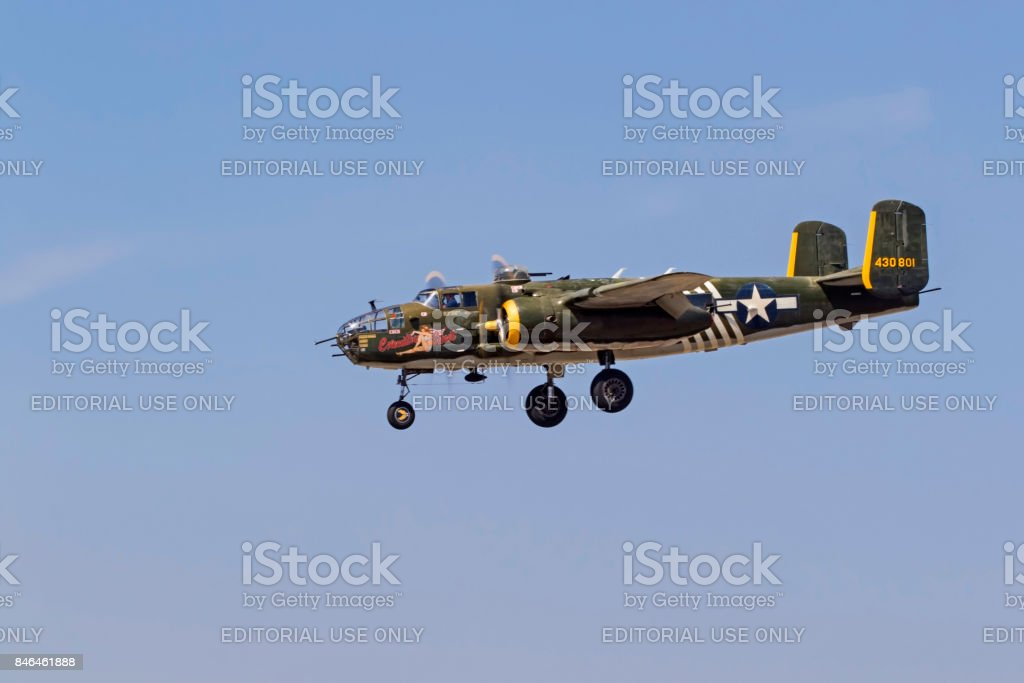 Airplane B-25 Mitchell bomber aircraft flying at the airshow stock photo