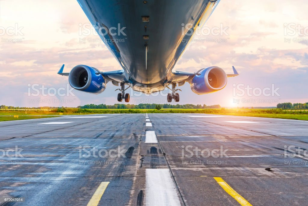 Airplane before landing, bottom view of engines and wings, wpp with lanshtafom before sunset stock photo