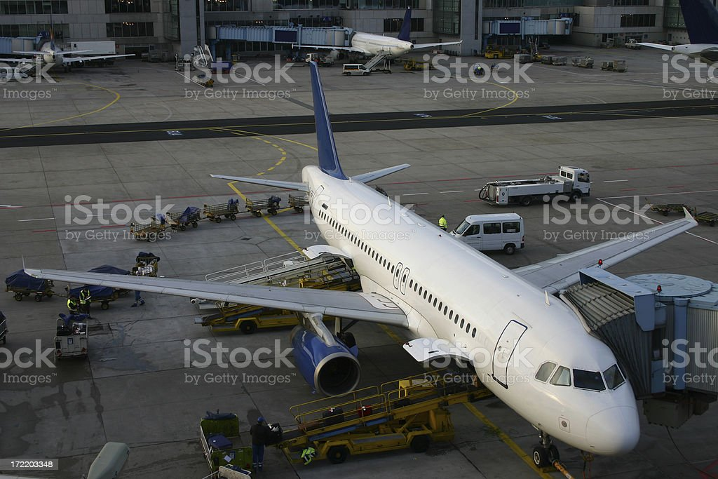 Airplane being loaded and boarded royalty-free stock photo