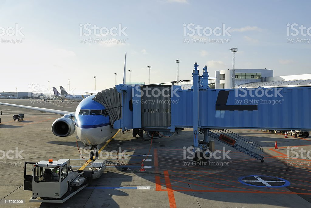 Airplane being reflueled royalty-free stock photo