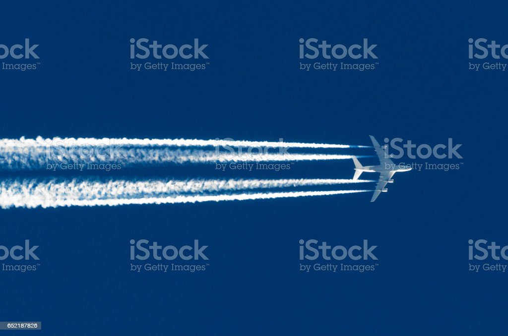 Airplane big four engines aviation airport contrail clouds stock photo