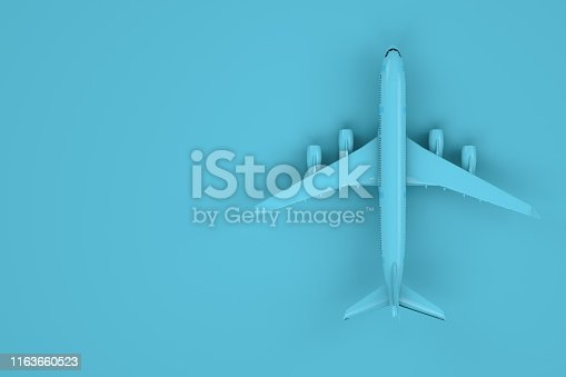 istock Airplane Blue, Minimal Travel Concept 1163660523