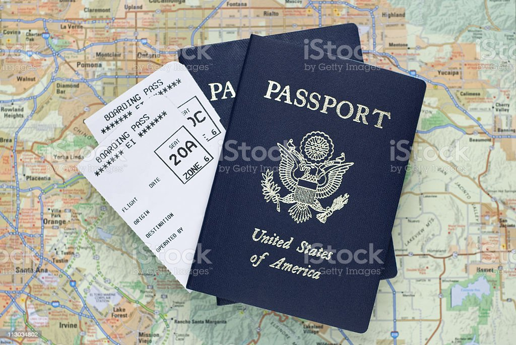 Airplane boarding passes and American passports over map royalty-free stock photo