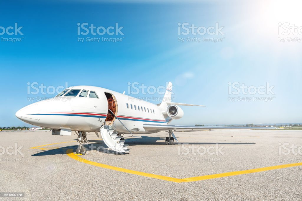 Airplane & boarding stairs stock photo