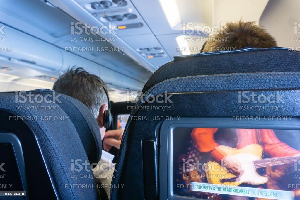 Airplane cabin interior in-flight stock photo