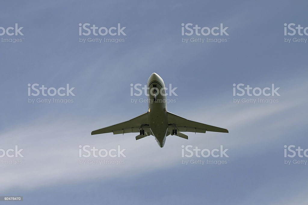 Airplane, centered in blue sky royalty-free stock photo